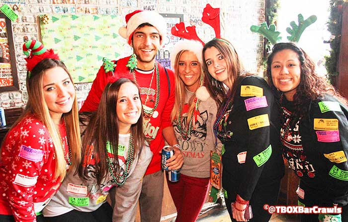 A Fun Group with TBOX Virgin Stickers at Festa Parties - 12 Bars of Xmas Pub Crawl